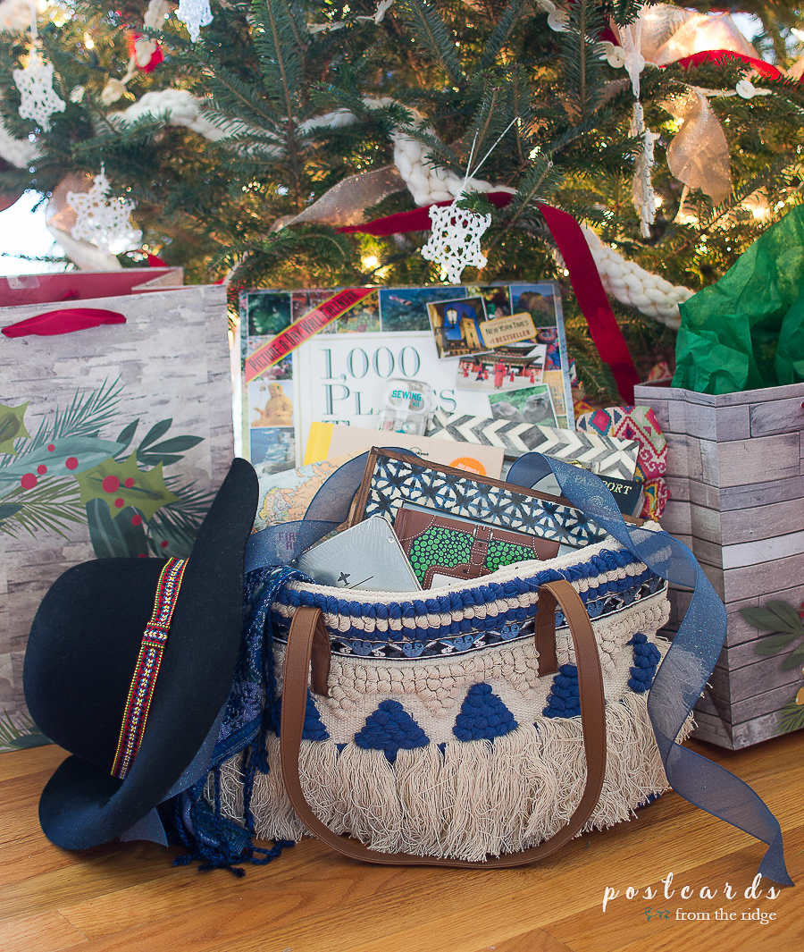 Blue fringed boho bag full of gift ideas for travelers