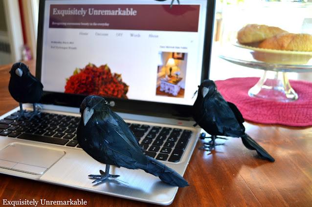 Faux Black Birds on a laptop