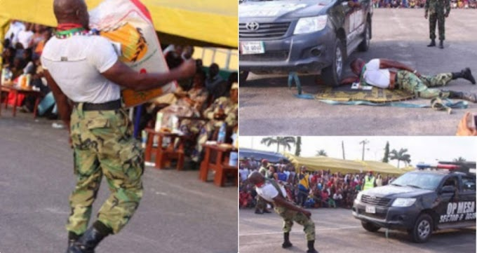 Photos: Nigerian soldier pulls a Hilux van, bag of rice using his teeth.