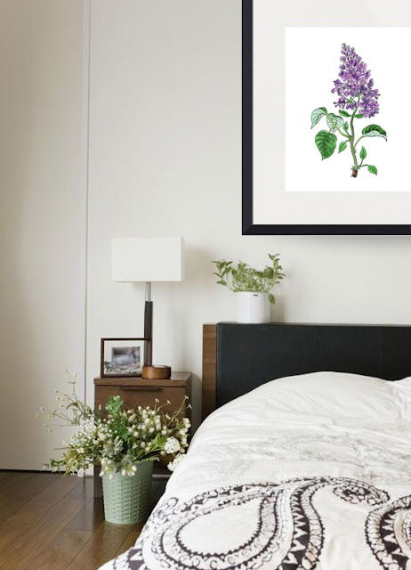 Lilac watercolor artwork framed in bedroom environment