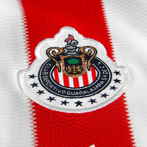 c808a8d1b83 ... 13-14 Home Kit are red with a navy trim at the bottom. Chivas shorts  are traditionally navy and this is the first time for the club to use red  shorts.
