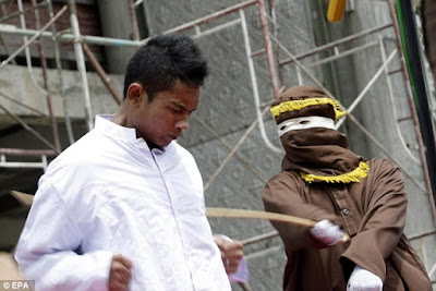 Public caning for committing immoral acts in Aceh, Indonesia