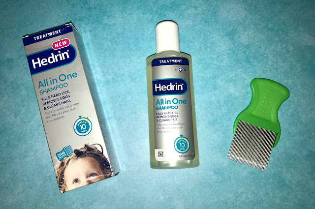 The box of Hedrin All in One Shampoo next to the bottle and the included nit comb