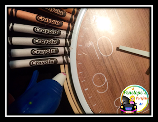 Gluing the crayons onto the support wall of a crayon clock