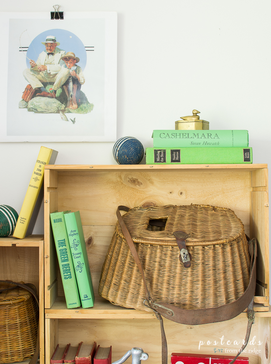 old books and wicker fishing basket
