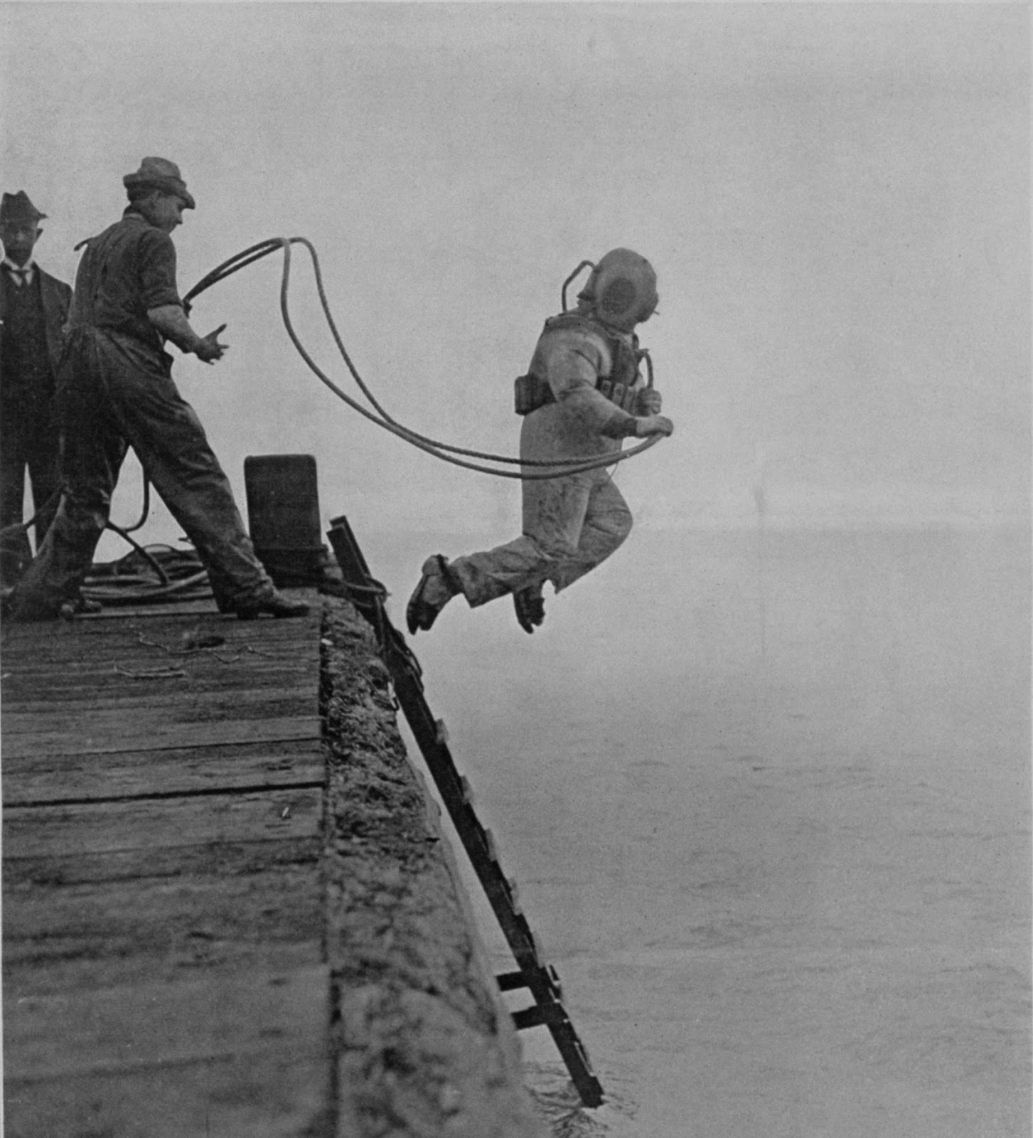 36 Amazing Historical Pictures. #9 Is Unbelievable - A deep sea diver is captured mid-jump. The cover of Scientific American Supplement on October 23, 1915