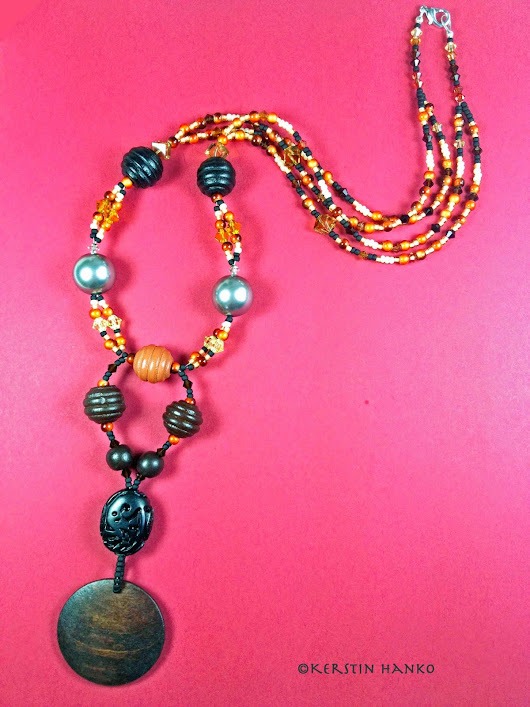 Ethno Style Necklace with carved Jet stone, wood pendant and pearls and Swarovski© crystals