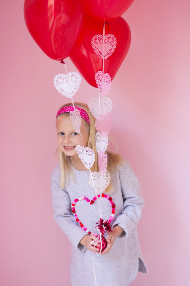 Add heart doilies to balloons to make the prettiest Valentine balloon bouquet!