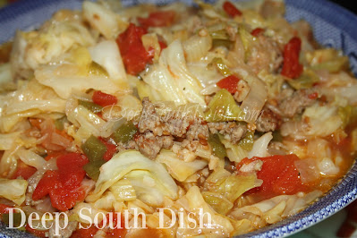 Chopped cabbage, smothered down with the trinity of vegetables, ground sausage and tomatoes.