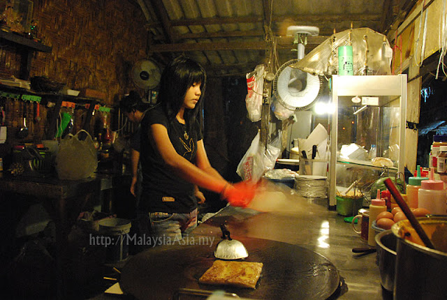 Girl Making Thai Pancakes