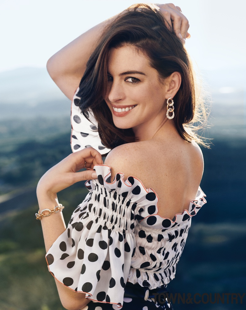 Anne Hathaway wears Carolina Herrera polka dot print top and pants with Pomellato earrings