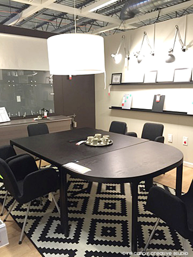 large office table & chairs, wall shelves, overheard lighting solutions