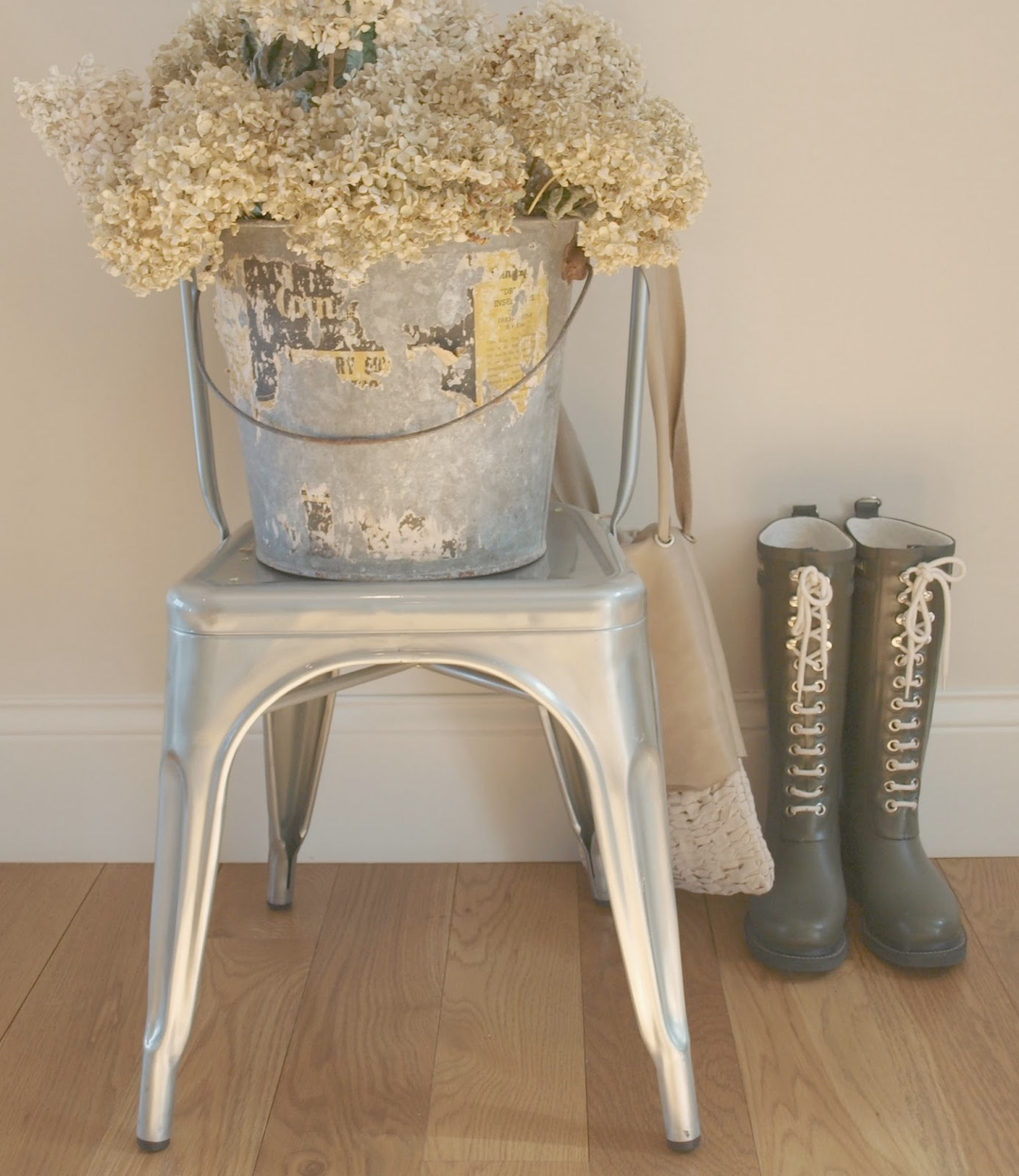Tolix chair, galvanized bucket, hydrangea, and wellies Hello Lovely Studio