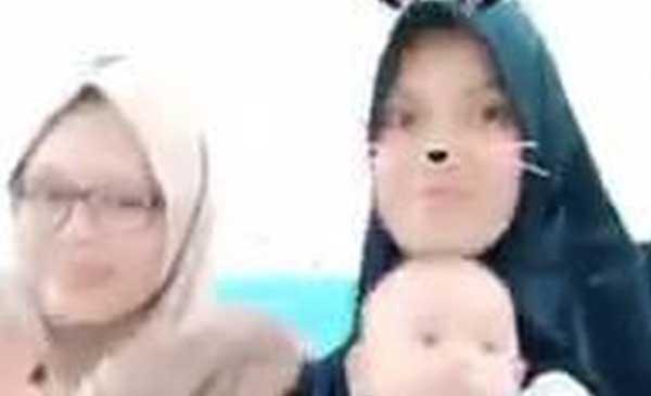 Video viral seorang bidan main tik tok sambil gendong bayi