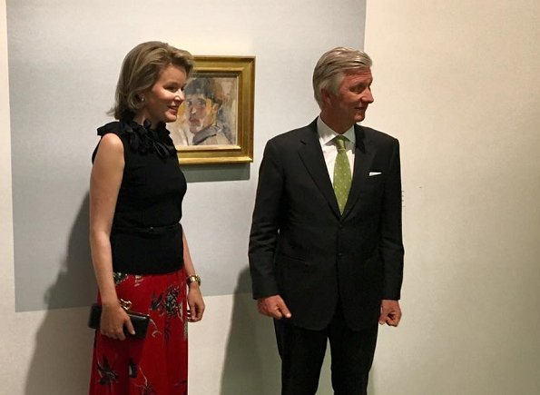 Queen Mathilde wore Natan floral skirt and Delphine Nardin Gold Earrings, The Queen carried Diane von Furstenberg black Elaphe clutch
