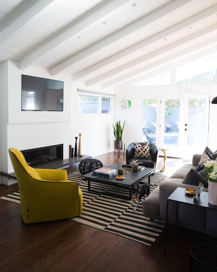 Midcentury modern living room with striped rug in Brendon Urie home