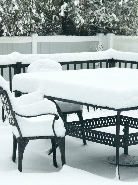 Patio set covered with snow