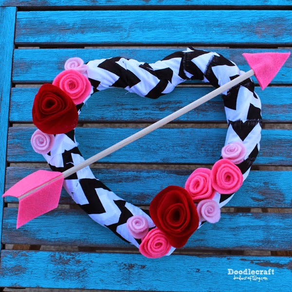 http://www.doodlecraftblog.com/2015/01/valentine-arrow-through-heart-wreath.html