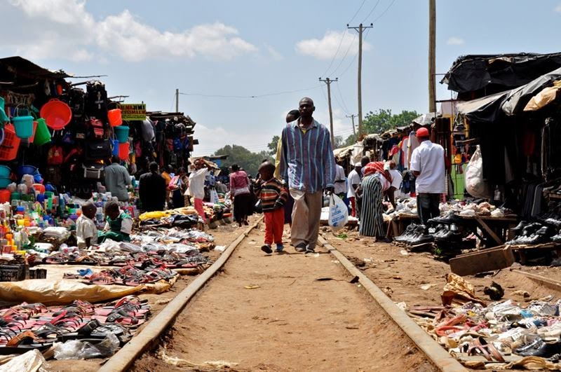 Railway track, Kibera Slum, Nairobi, Because there are no paved roads in Kibera, residents use the active railway track that cuts through the area's center as their main pedestrian thoroughfare.