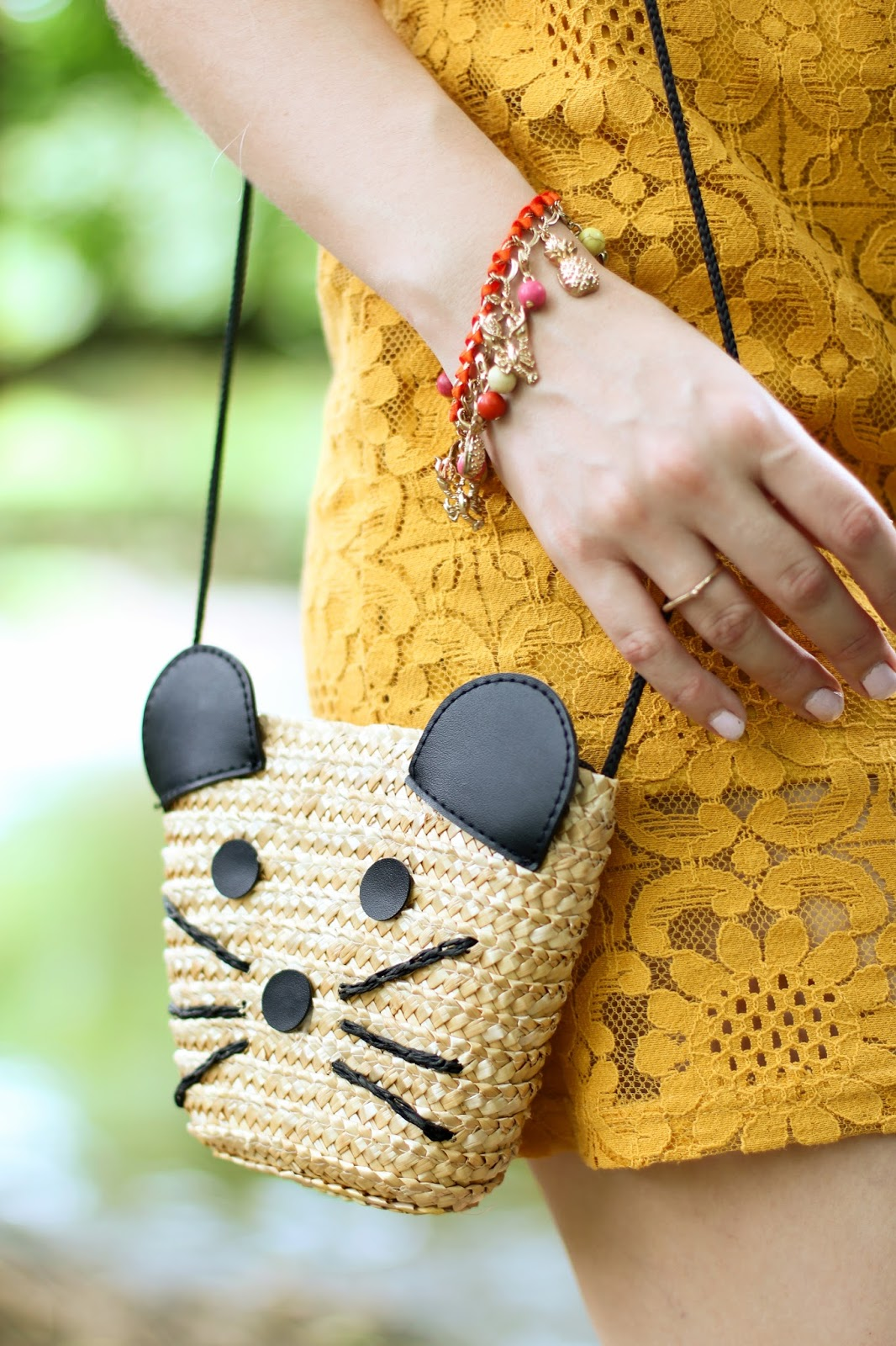 Loving this adorable mouse shaped purse!