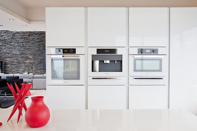 Picture of three elevated modern ovens in the kitchen