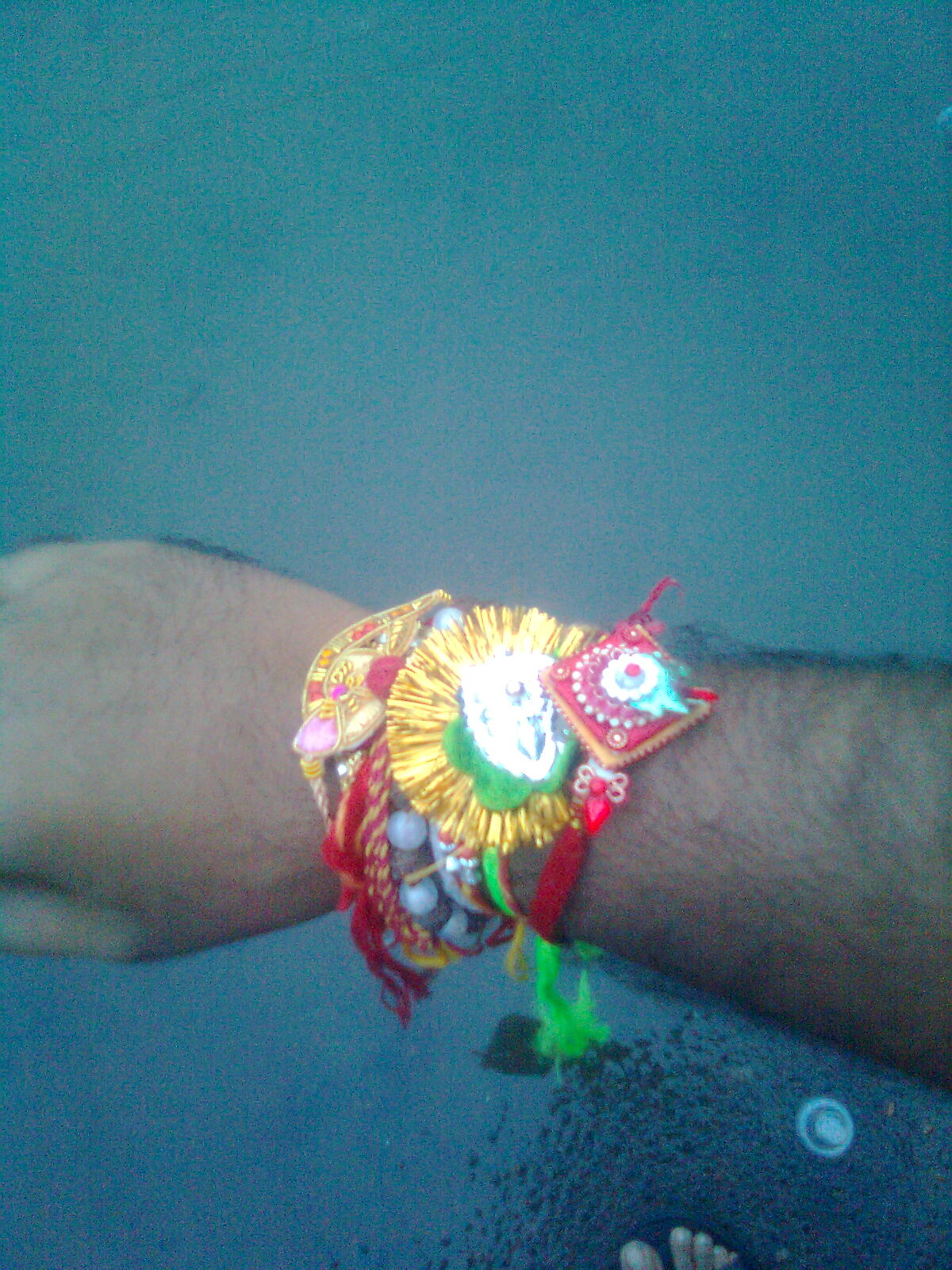 my wrist with rakhi in raksha bandhan day of brothers and sisters
