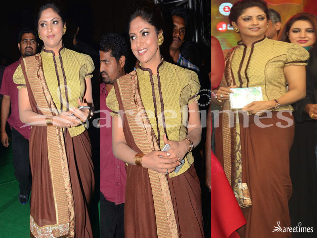 507946ffe3c6c0 Nadhiya at the audio launch of Bruce Lee in a brown chiffon saree draped in  Marwari style paired with gold brocade corset blouse.