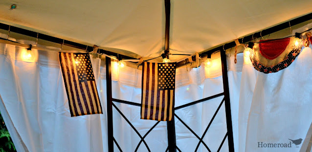 Flags and lights in outdoor canopy