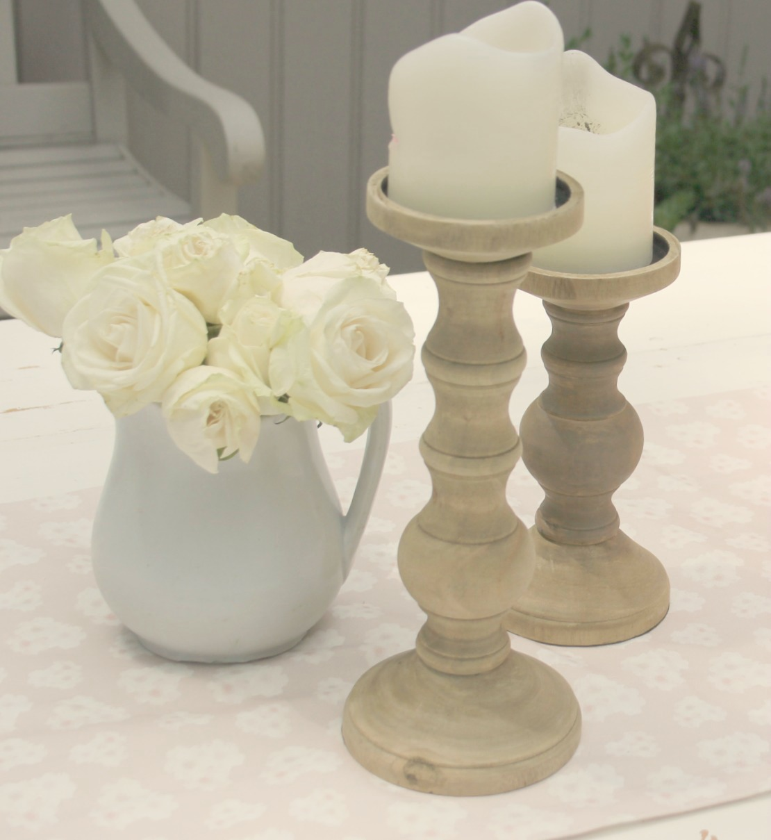 White ironstone pitcher with white roses and wood candlesticks - Hello Lovely Studio