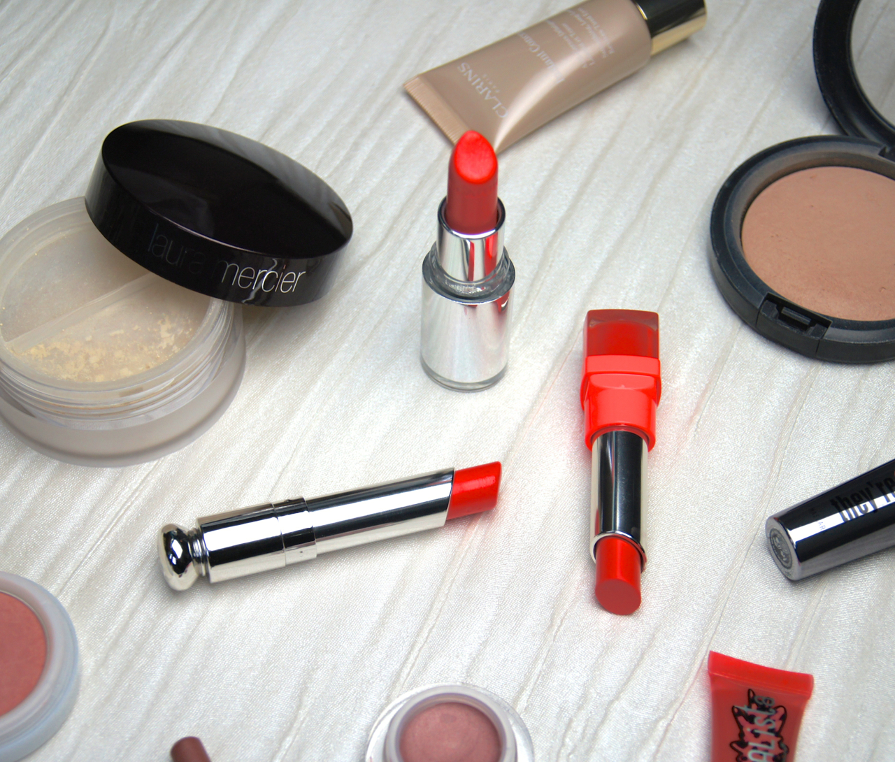save spend splurge glossy coral lipsticks dior clarins bourjois swatches