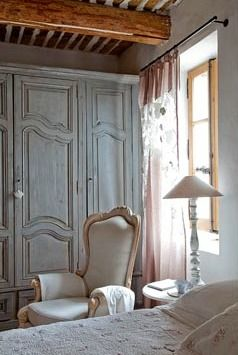 Breathtaking European farmhouse decorated room with blue paneled armoire doors. Inspiring European Country Home Ideas {French Country Decor Inspiration}