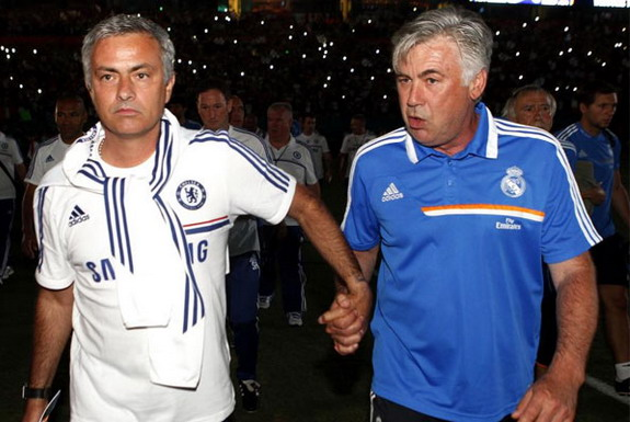 José Mourinho holds hands walking with Carlo Ancelotti