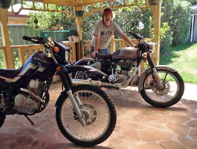 Graham Warrender with two motorcycles.