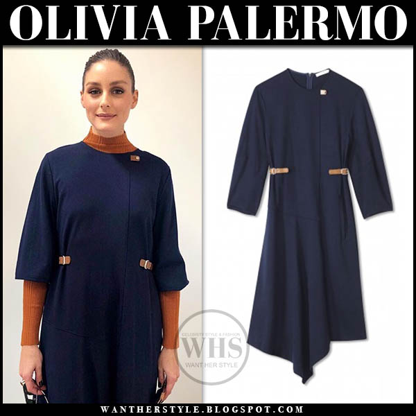 Olivia Palermo wears navy blue tibi midi dress with leather buckles, brown sweater and blue boots new york fashion week outfits 2019