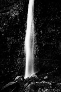 Cramer Imaging's fine art landscape black and white or monochromatic photograph of a soft and silky waterfall cascading down in Twin Falls Idaho
