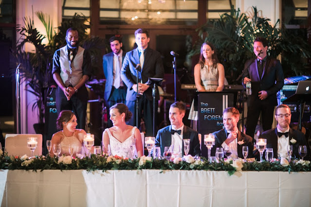 live music behind wedding party table