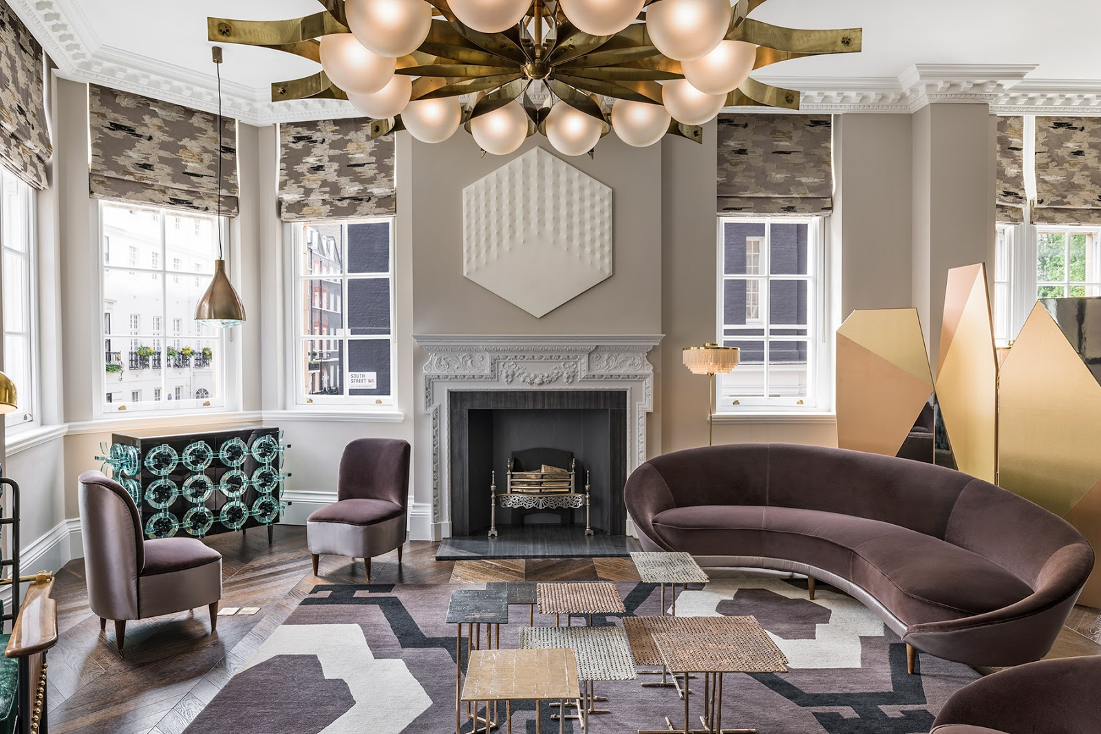 Luxurious eclectic London apartment with pattern geometric rugs, mid century modern furniture and art