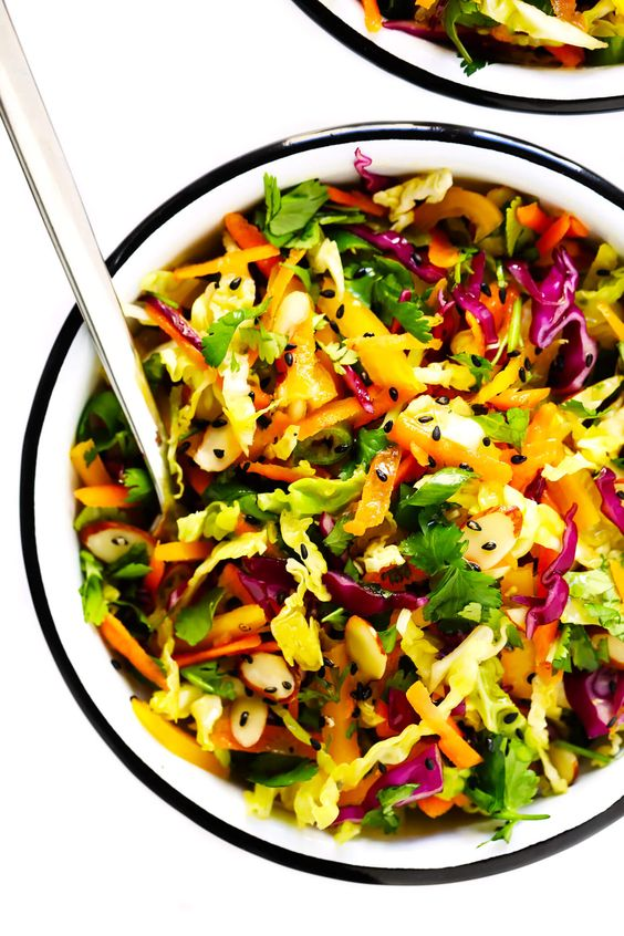 This easy Sesame Asian Slaw recipe is quick and easy to make, tossed with the yummiest sesame vinaigrette, and can easily double as a side salad or big entree salad. Feel free to add in a cooked protein (such as chicken, steak, shrimp or tofu) and an avocado to really kick this slaw up a notch! | gimmesomeoven.com #asian #salad #slaw #side #healthy #glutenfree #vegetarian #vegan #makeahead #mealprep #dinner