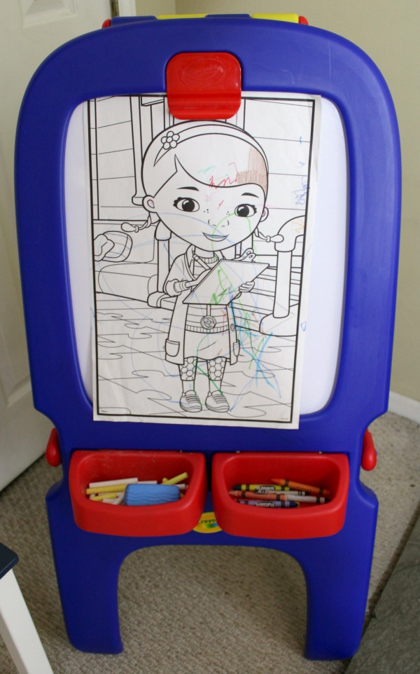 Organized art station for kid's art and craft supplies: Easel