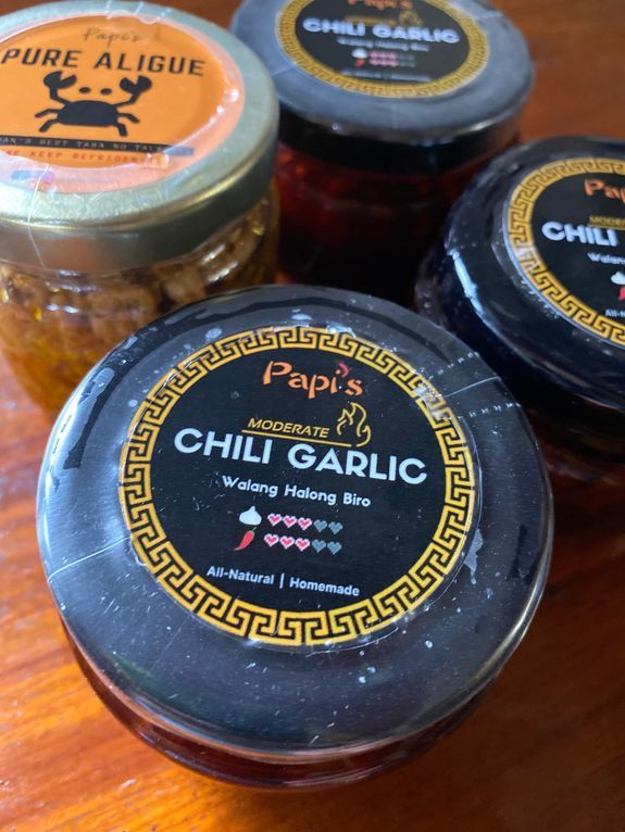 Bottles of Papi's Chili Garlic and aligue or crab fat