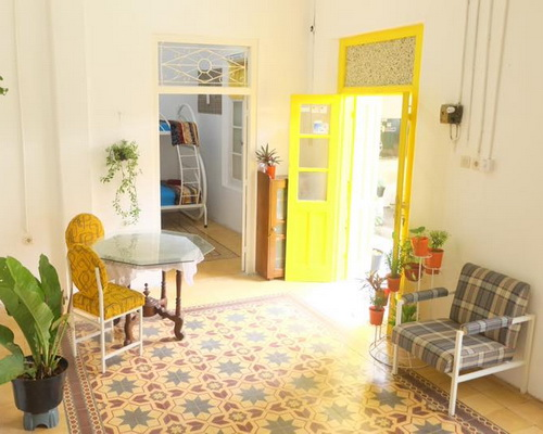 www.Tinuku.com Benetta House add yellow paint to unify impression pop into colonial architecture and classic-vintage interior