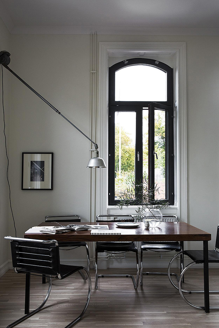 How to light a dining room without a ceiling light, alternative dining room lighting ideas, lighting above the dining table, swing arm wall lamp above the dining table, long arm wall lamp in the dining room. Photo via Fantastic Frank