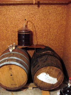 Refilling the apple brandy barrel with more beer.