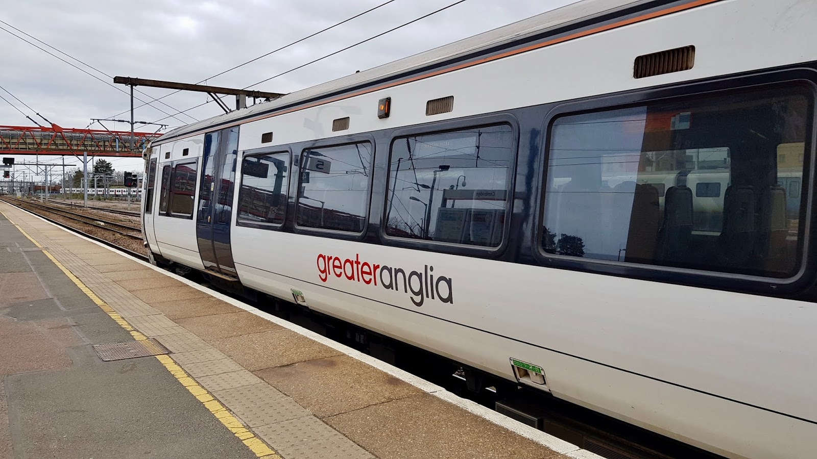 A Greater Anglia train standing at Cambridge train station