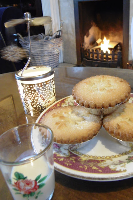 mince pies in front of real fire