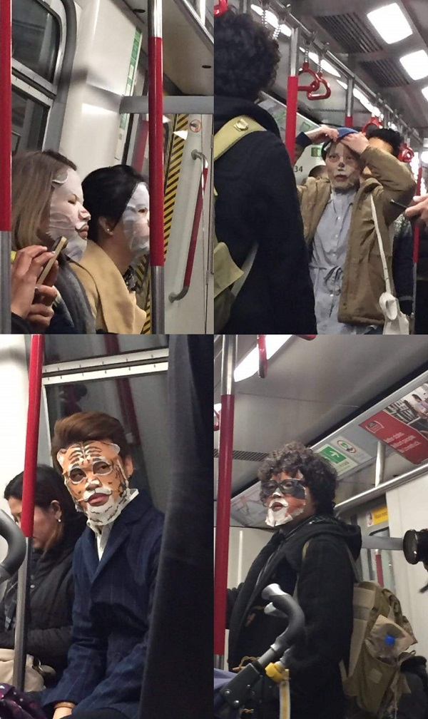 passengers using animated face mask sheets in Tokyo subway