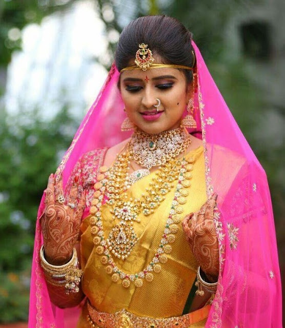 Bride in Long Ram Leela Haram Mango Set