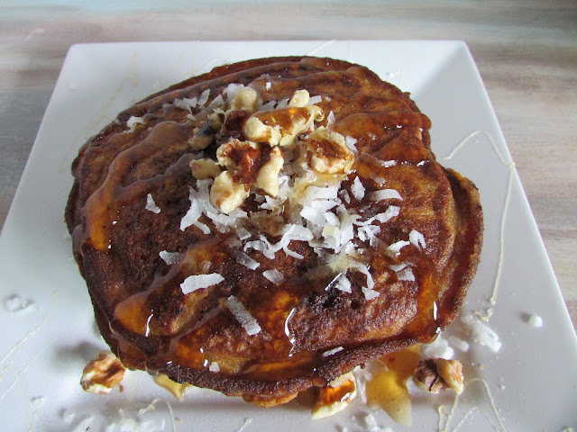 pumpkin pancake on a plate with coconut and walnuts