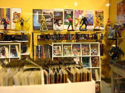 Interior view of a modern dolls' house miniature comic book shop