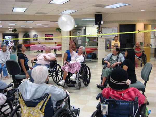 wheelchair volleyball light gray chair covers serving up a game of hale makua health services yesterday residents and staff teamed to play in the activity center named their teams kuaina against nokaoi